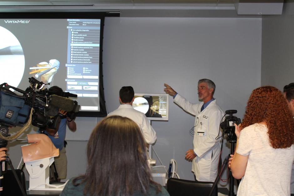 Dr. Michael Daubs demonstrates the virtual surgery simulator